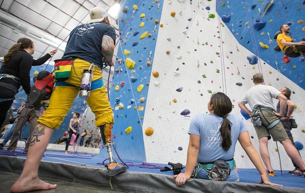 James Scheri and Jess Sporte belaying at Earth Treks Climbing Club in 2018