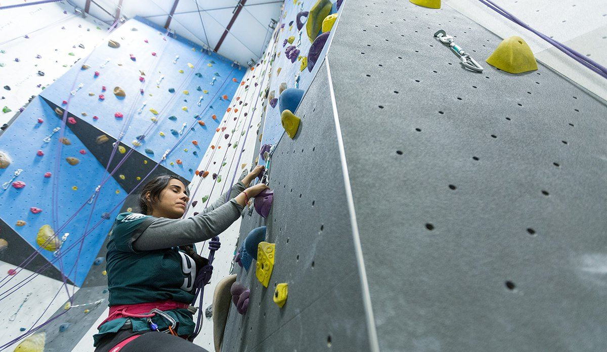 Climber on the wall at Climbing Club at Earth Treks in 2018
