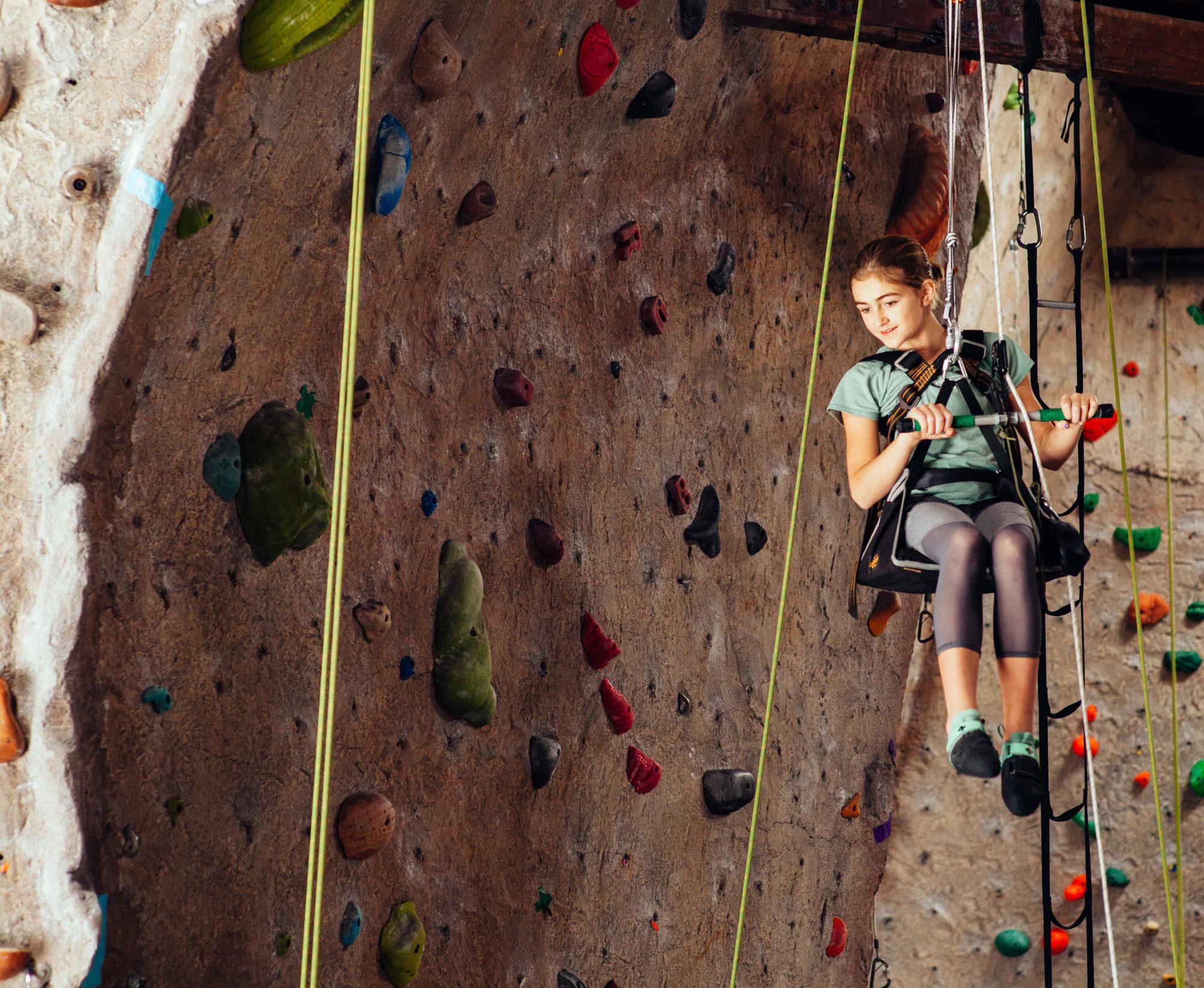 Climber Climbing at ACI Course at Sanctuary Rock Gym in CA