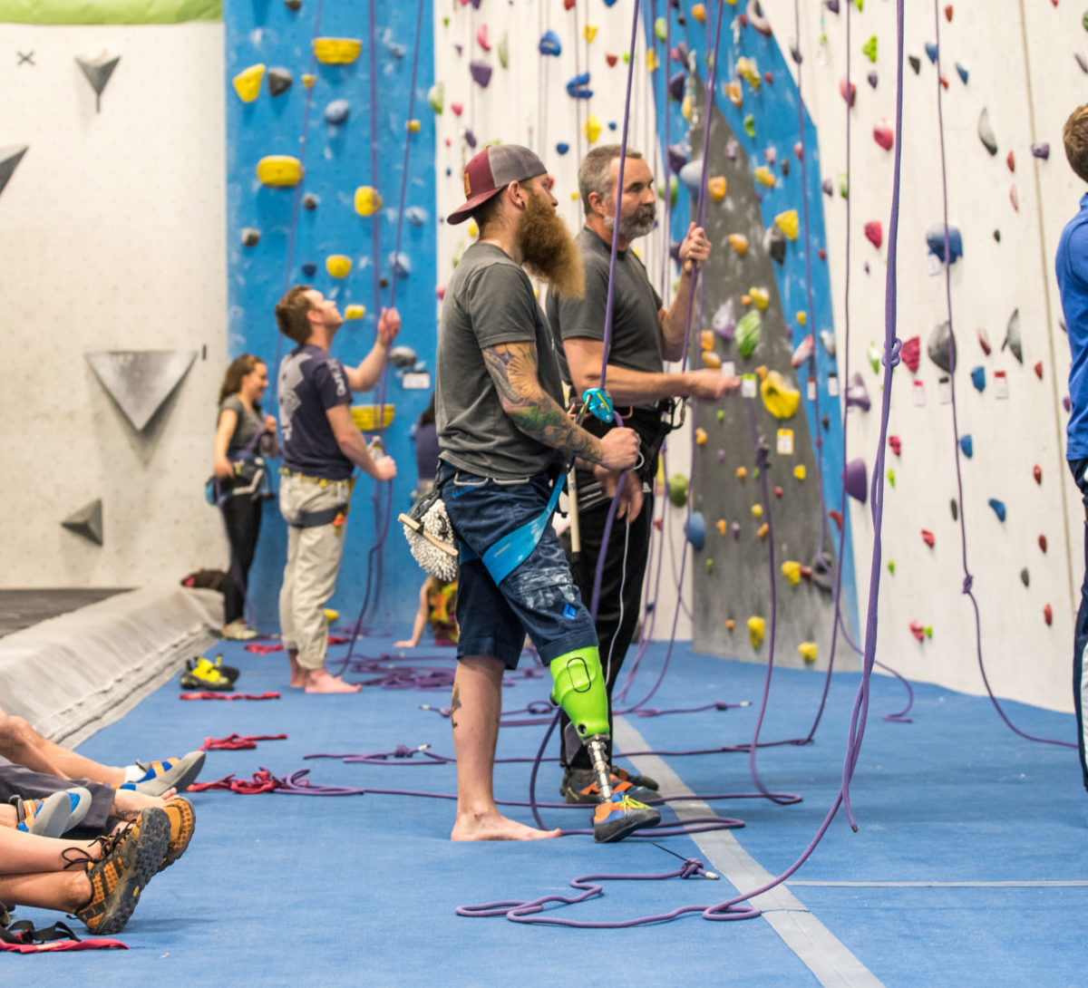 James Scheri Belaying at Adaptive Climbing Club Night at Earth Treks