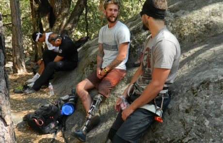 Climbers in Prosthesis Chatting at Crag