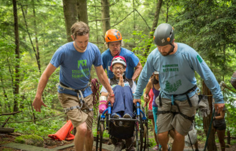 Volunteers Helping Woman in Wheelchair to Crag