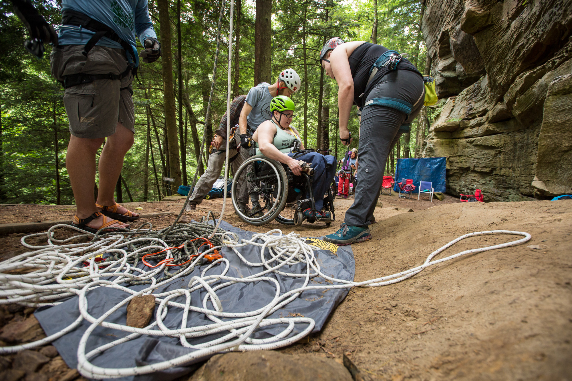 Volunteers Helping Woman in Wheelchair at Crag